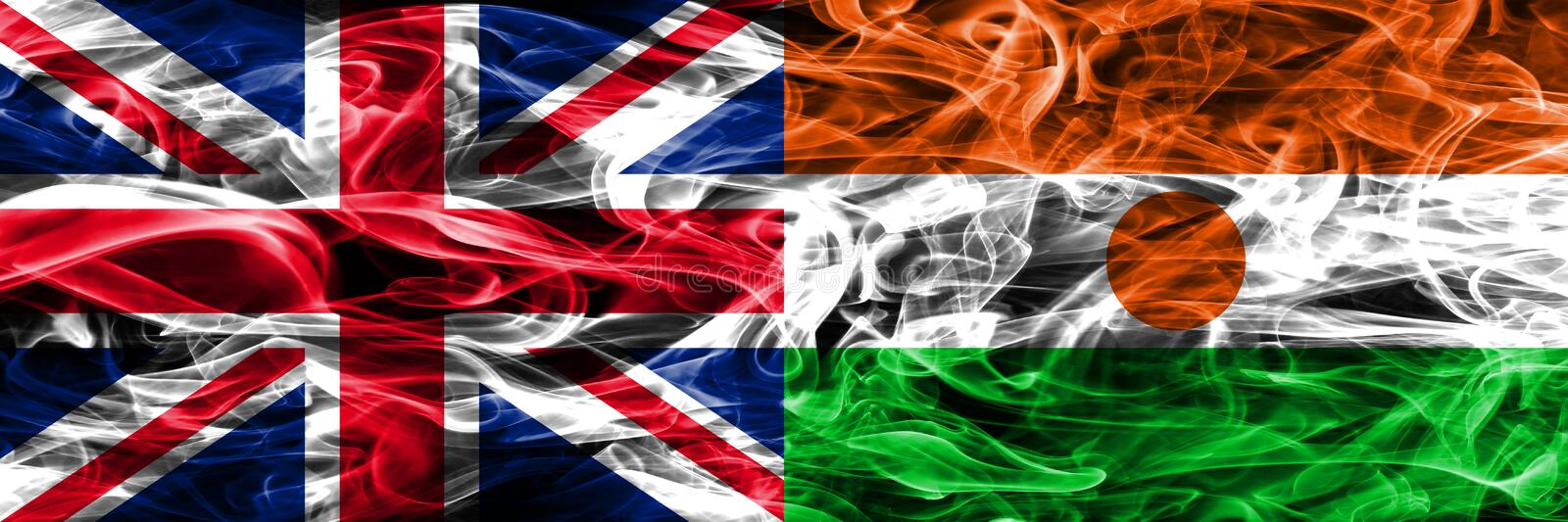 United Kingdom vs Niger smoke flags placed side by side. Thick colored silky smoke flags of Great Britain and Niger.  stock image
