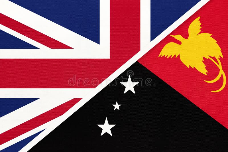 United Kingdom vs Papua New Guinea national flag from textile. Relationship between two European and Oceania countries. United Kingdom of Great Britain and stock photo