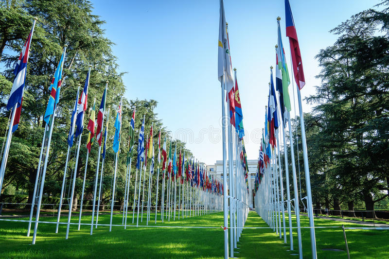 United Nations in Geneva. View of the entrance to United Nations (Palace of Nations) and the gallery of the National Flags in Geneva, Switzerland. Photo taken on royalty free stock photos