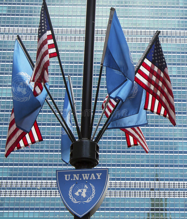United Nations and Unitred States Flags. NEW YORK CITY - MARCH 20 United Nations and United States Flags in the front of UN Headquarter in New York on March 20 stock photography