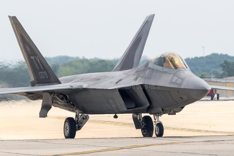 F-22 Raptor at the Rockford Airshow. A United States Air Force F-22 Raptor performs a demo at the 2015 Rockford Airfest royalty free stock photography