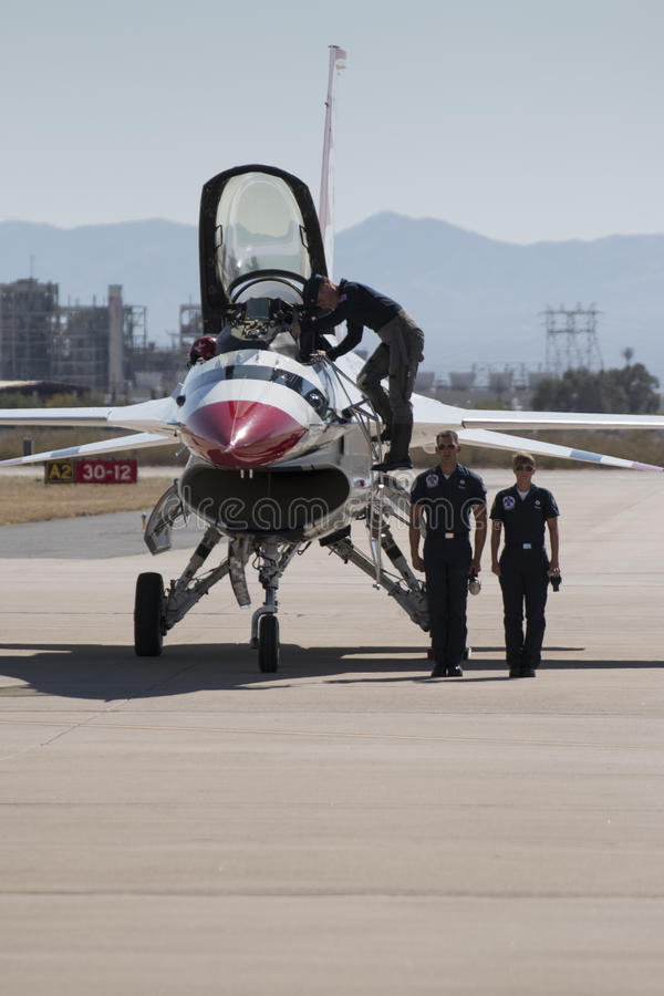 United States Air Force Thunderbirds. The United States Air Force Thundbirds Air Demonstration Team flight crew stands by as their pilot climbs down from his F stock photography