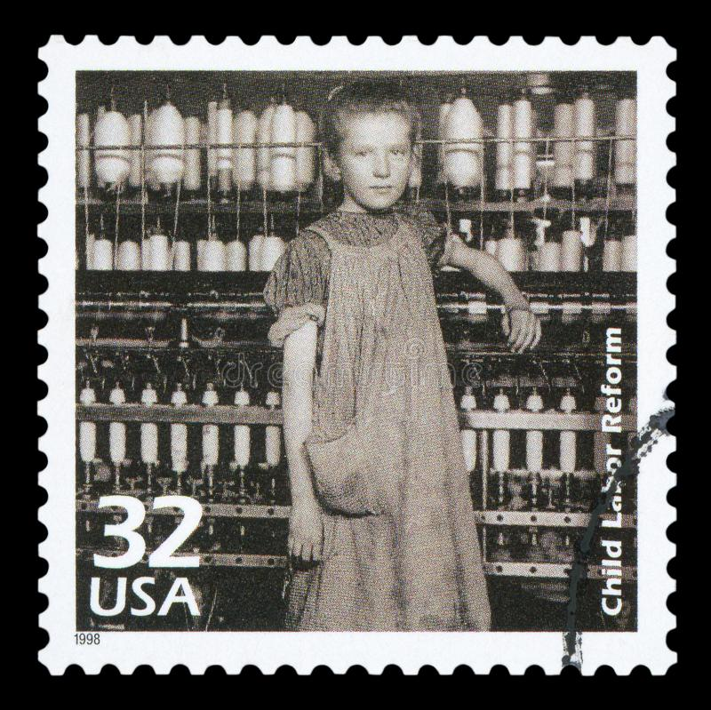 US - Postage Stamp. UNITED STATES OF AMERICA - CIRCA 1998: a postage stamp printed in USA showing an image of a girl working as a spinner in a cotton mill to royalty free stock image