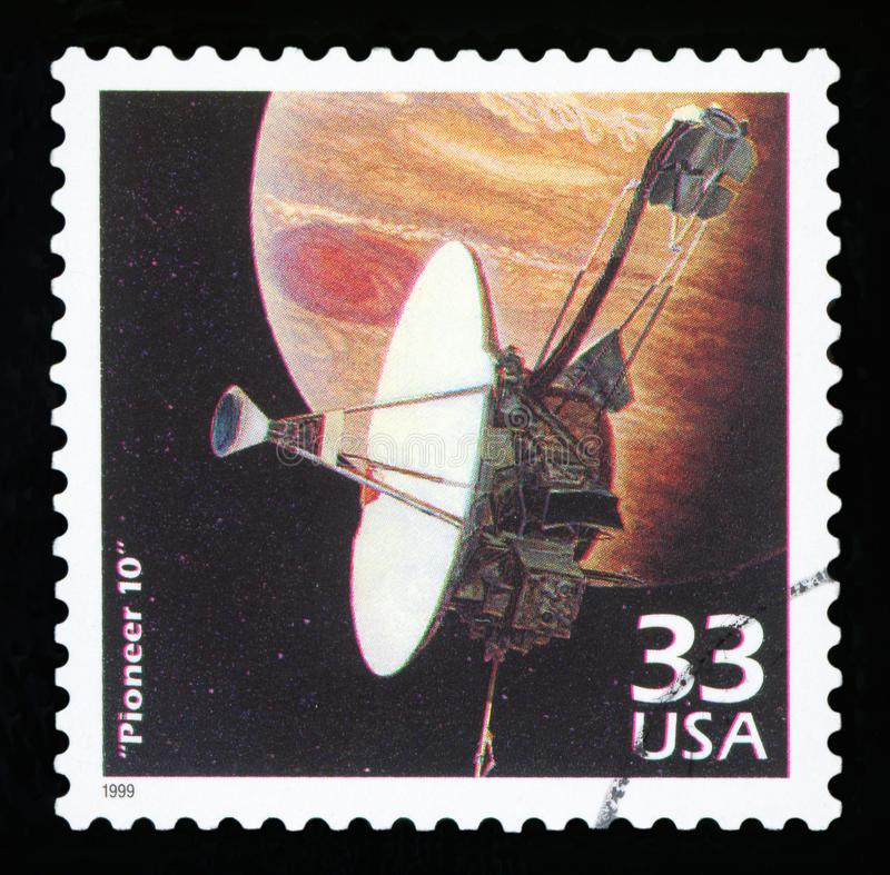 US Postage stamp. UNITED STATES OF AMERICA - CIRCA 1999: a postage stamp printed in USA showing an image of Pioneer 10 a robotic space probe that completed the stock photos