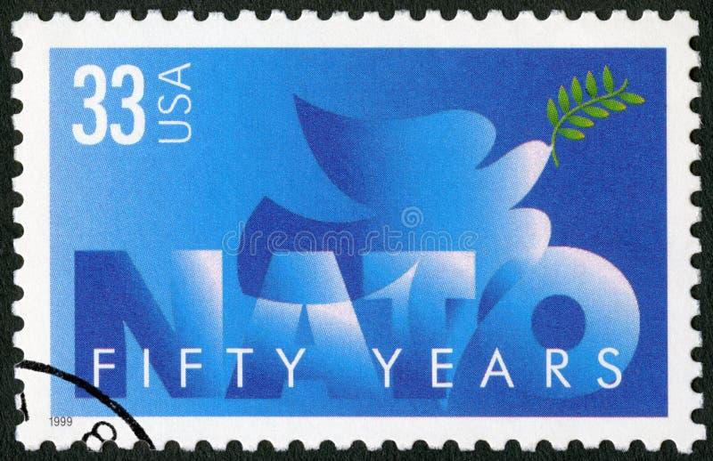 USA - 1999: devote NATO, 50th Anniversary. UNITED STATES OF AMERICA - CIRCA 1999: A stamp printed in USA devote NATO, 50th Anniversary, circa 1999 royalty free stock photo