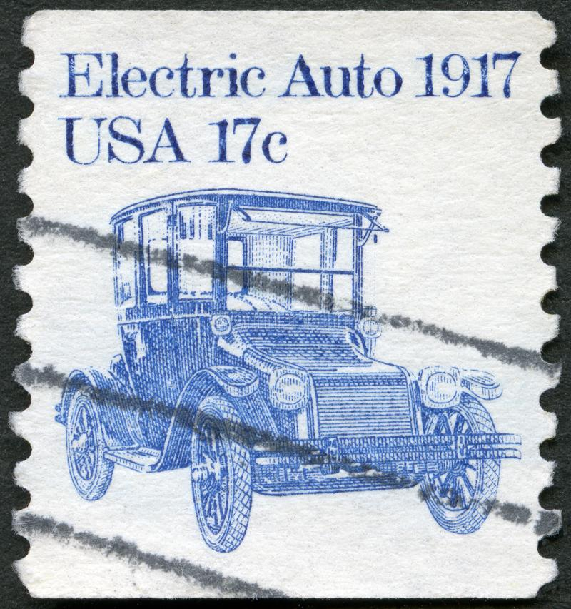 USA - 1985: shows Electric Auto 1917, series Transportation Colls series. UNITED STATES OF AMERICA - CIRCA 1985: A stamp printed in USA shows Electric Auto 1917 stock photos