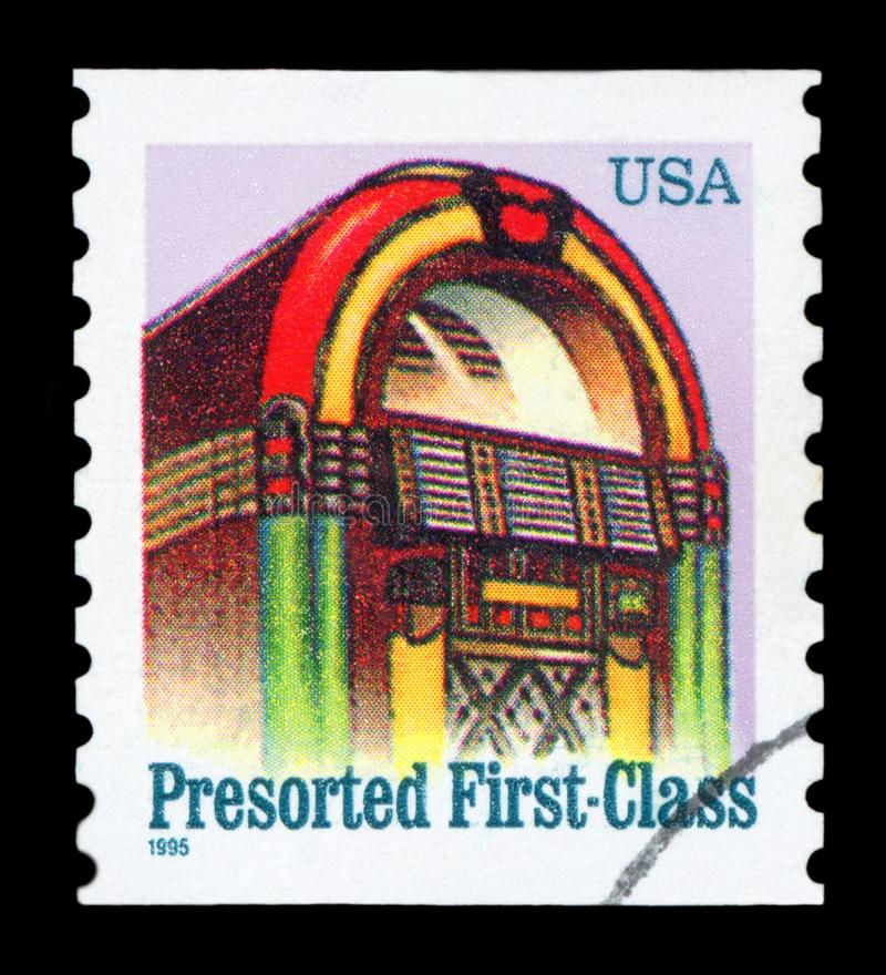 US Postage stamp. UNITED STATES OF AMERICA - CIRCA 1995: A stamp printed in USA shows jukebox, presorted first class, circa 1995 stock photo