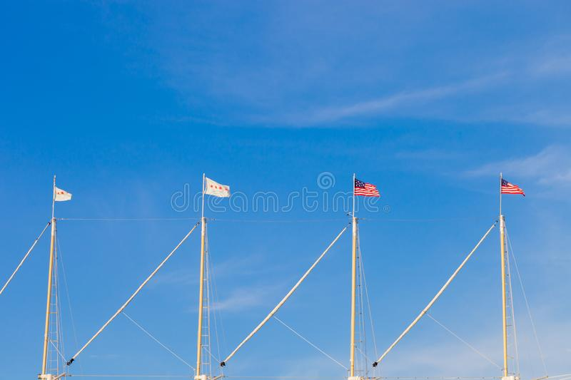 The United States of America flag and the city of Chicago flag f. Lying on the masts of a sailing vessel royalty free stock photos