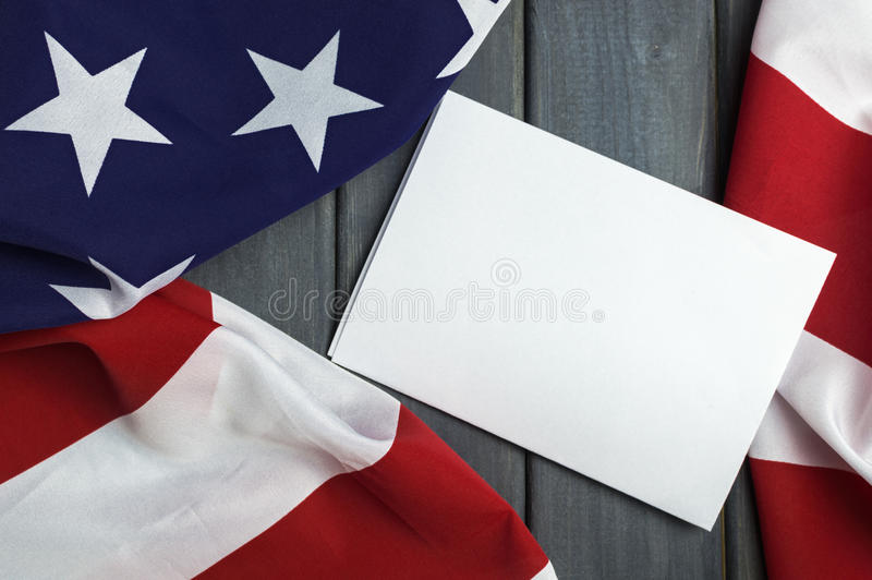 United States of America flag with empty space to write your text on sheet of paper on wooden background.  royalty free stock photos