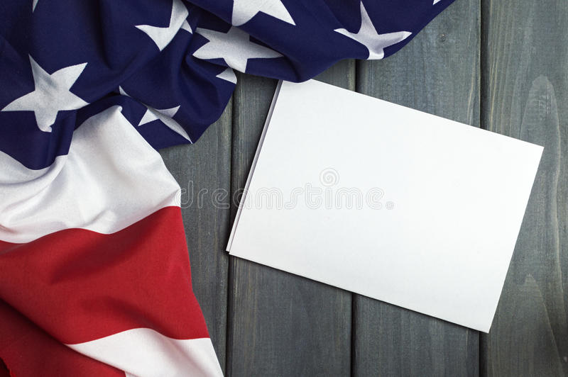 United States of America flag with empty space to write your text on sheet of paper on wooden background.  stock photos