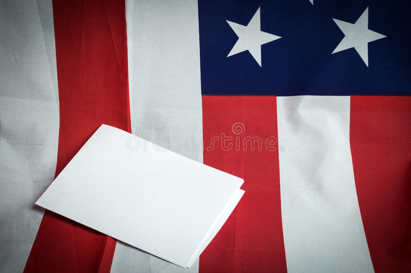 United States of America flag with empty space to write your text on sheet of paper on wooden background.  stock images