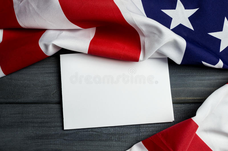 United States of America flag with empty space to write your text on sheet of paper on wooden background.  royalty free stock photo