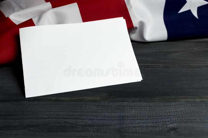 United States of America flag with empty space to write your text on sheet of paper on wooden background.  stock photography