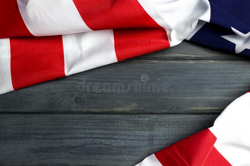United States of America flag with empty space to write your text on wooden background.  stock photo