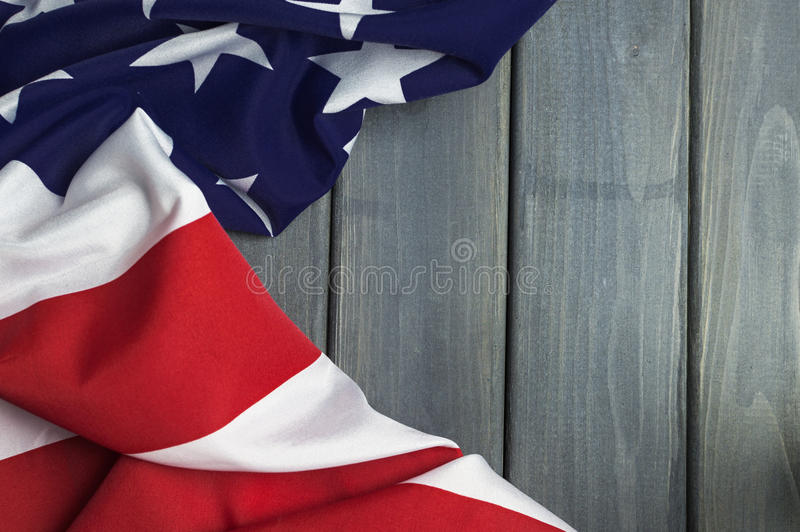 United States of America flag with empty space to write your text on wooden background.  stock photography