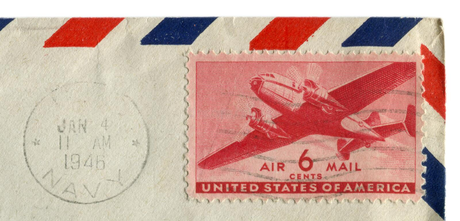 The United states of america - 4 Jan 1946: American historical stamp: six cents airmail with transport and passenger aircraft, bla. Ck ink postal cancellation royalty free stock photo