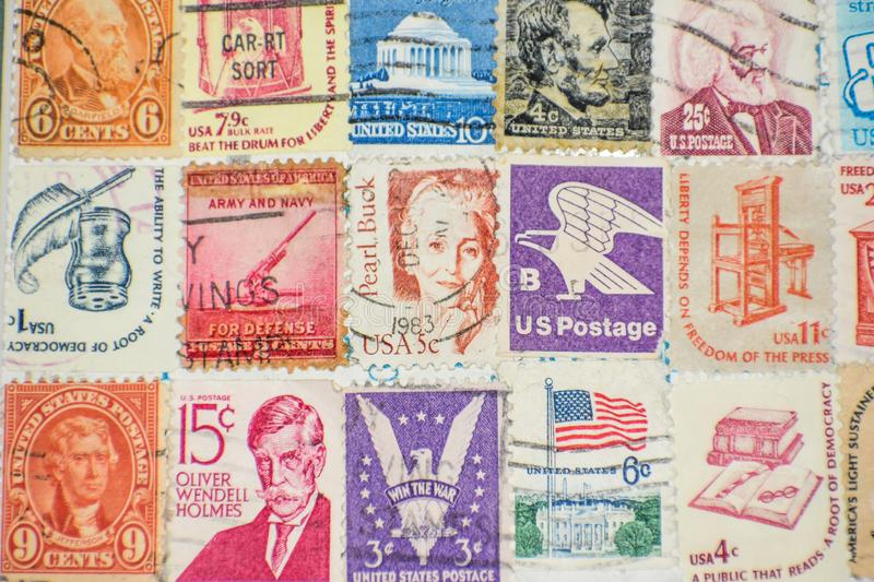 United States of America Postage Stamp Collection Background. A collection of old United States of America Postage Stamps. Dwight D. Eisenhower, Abraham Lincoln royalty free stock photography