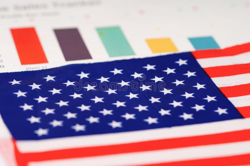 United States of America USA flag on chart graph paper. Finance concept royalty free stock photo