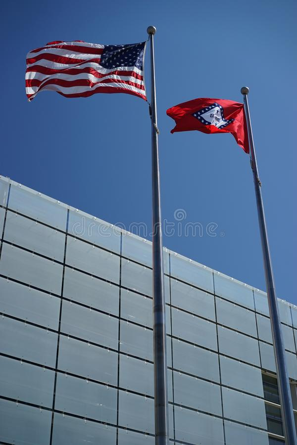 United States and Arkansas flags. Flying parallel in the wind stock image
