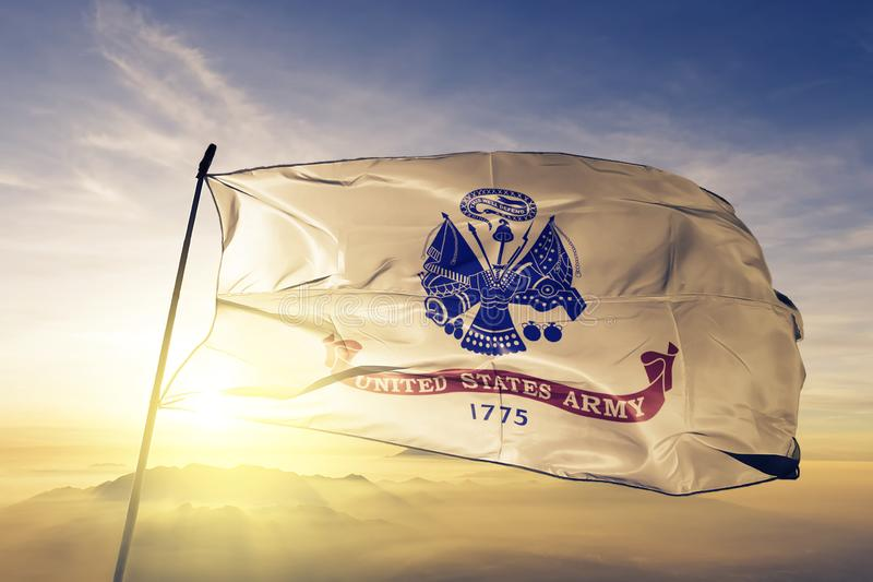 United States Army flag textile cloth fabric waving on the top sunrise mist fog stock illustration