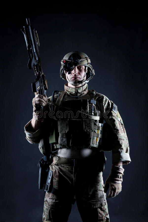 United States Army ranger. With assault rifle on dark background royalty free stock image