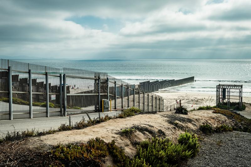 United States Border Wall with Mexico meeting the Pacific Ocean in California royalty free stock images