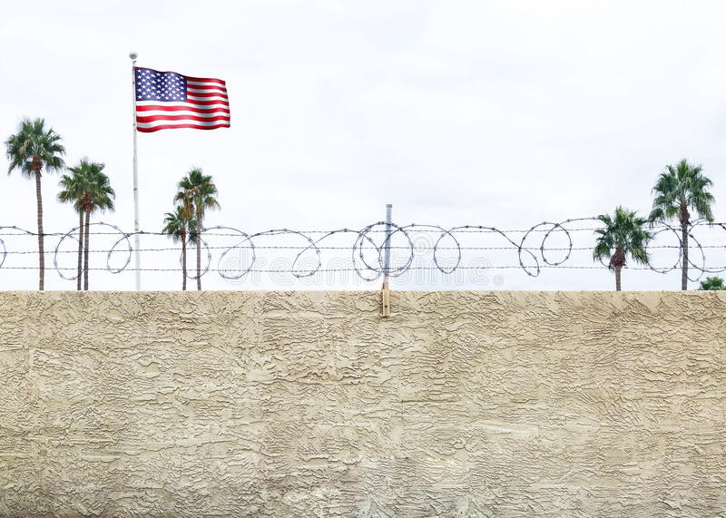 United States Border Wall. Wall with secure barbed wire fence along the southern border of the United States royalty free stock image