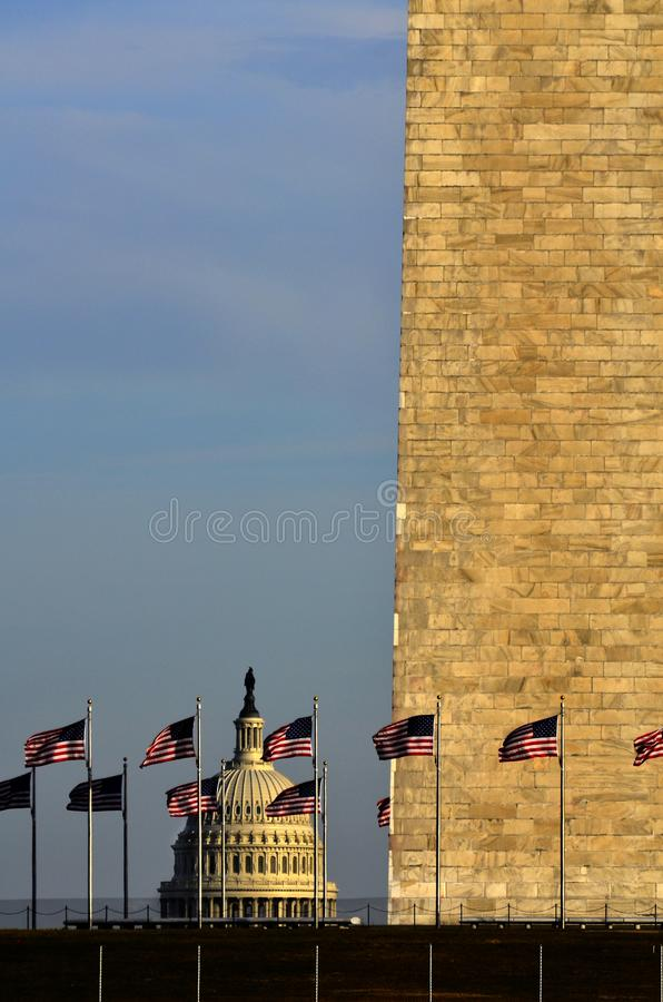 United States Capitol with American Flags and Washington Monument. United States Capitol building with American Flags and Washington Monument royalty free stock photo