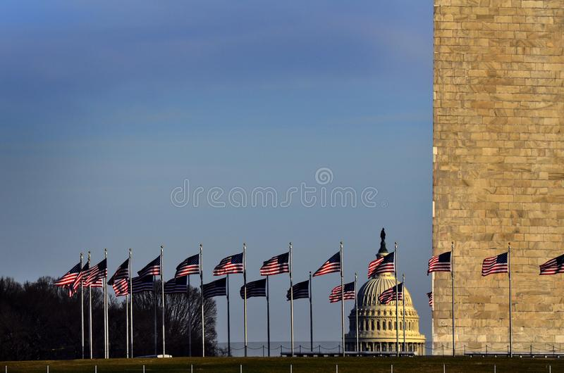 United States Capitol with American Flags and Washington Monument. United States Capitol building with American Flags and Washington Monument stock image