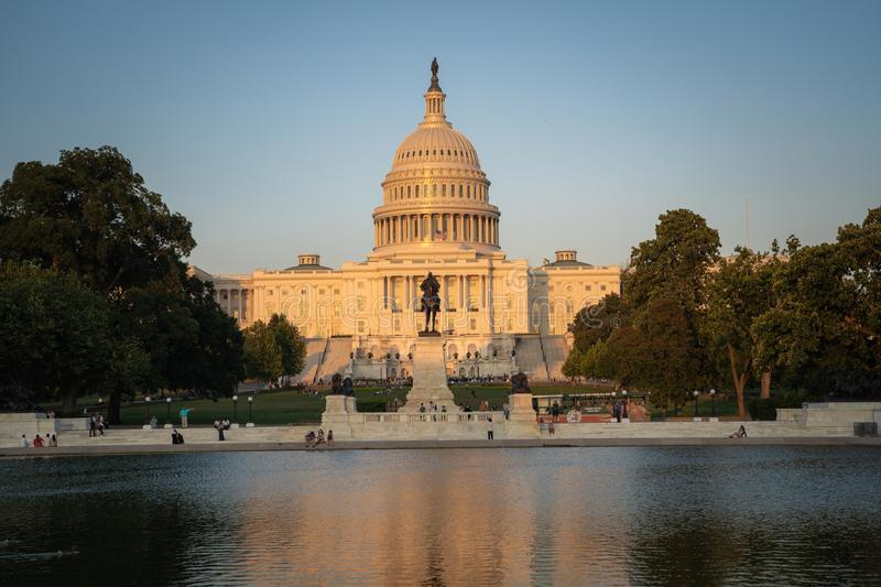 United States Capitol building at dusk sunset during a summer day, glowing from sunshine, with reflecting pond.  royalty free stock images