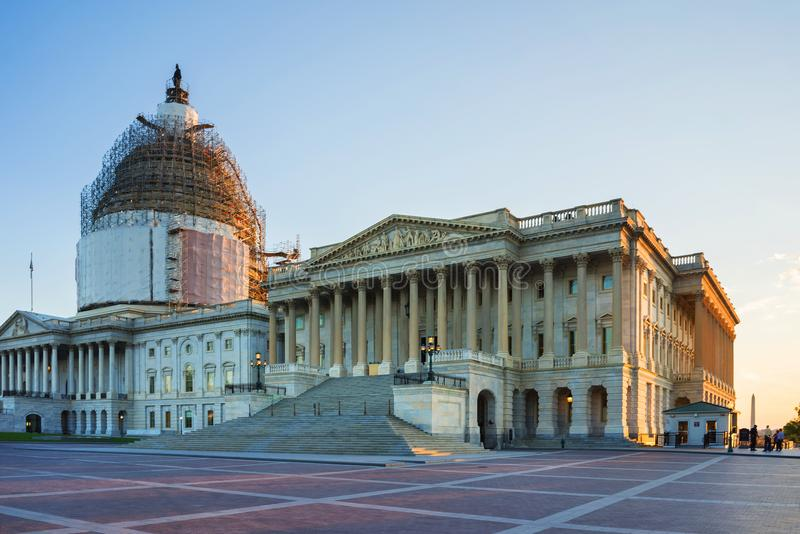 United States Capitol and reconstruction works Washington US. Washington DC, USA - May 3, 2015: United States Capitol locates on a top of a Capitol Hill in stock photography