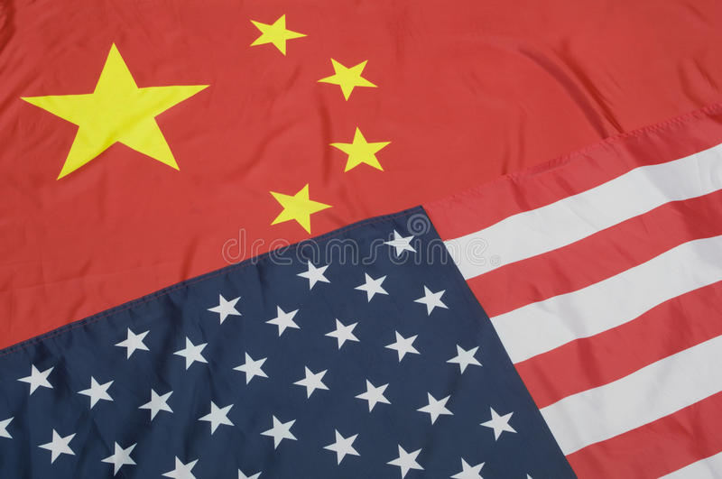 United States and China Flags. Closeup of Flags of United States Of America and China - Shallow Depth Of Field royalty free stock images