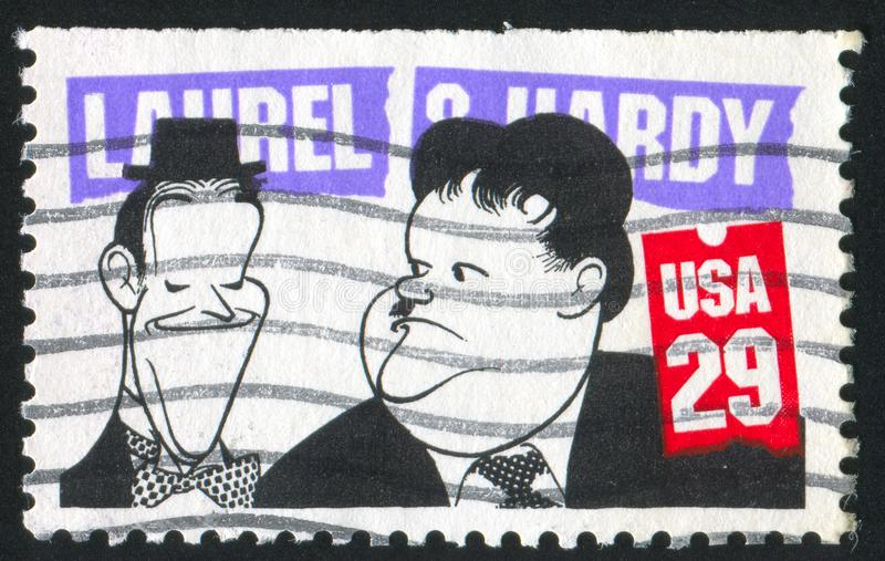 Caricature. UNITED STATES - CIRCA 1991: stamp printed by United States of America, shows caricature of Laurel and O`Hardy, circa 1991 royalty free stock photos