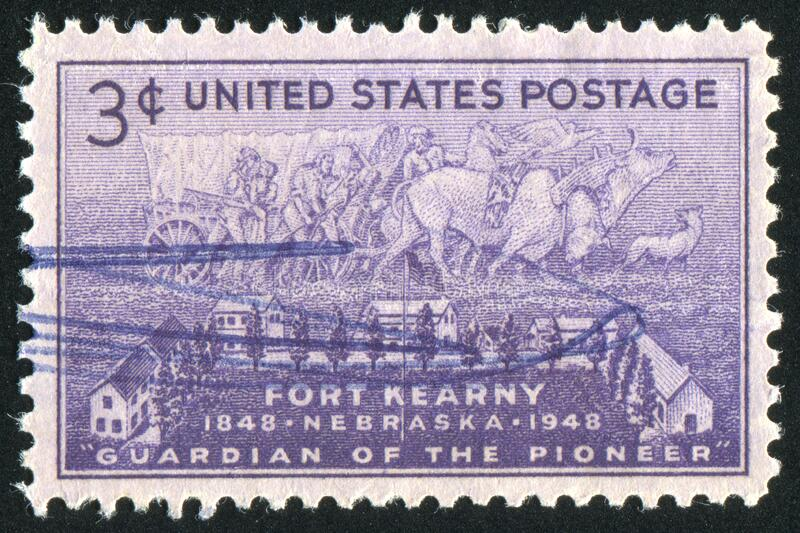Postage stamp. UNITED STATES - CIRCA 1948: stamp printed by United states, shows Fort Kearny and Pioneer Group, circa 1948 royalty free stock photos