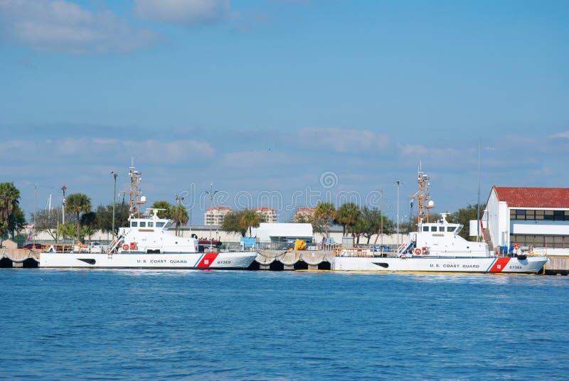 United States Coast Guard boats St. Pete Florida. Two United States Coast Guard boats docked at the Saint Petersburg Florida Coast Guard station stock photos