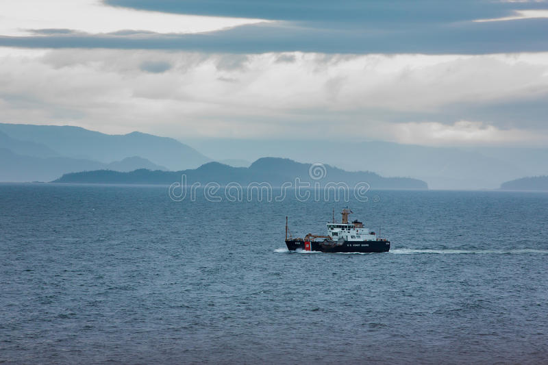 United States Coast Guard Cutter Anthony Petit. United States buoy tender in the Alaskan Inner Passage stock photos