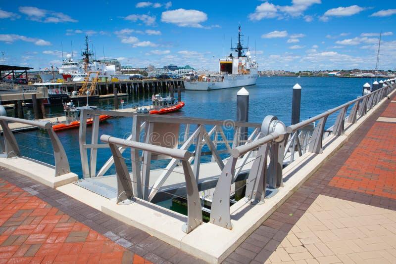 United States Coast Guard ships docked in Boston Harbor, USA. Boston, Massachusetts, USA - July 7, 2016 : United States Coast Guard ships docked in Boston Harbor stock photography