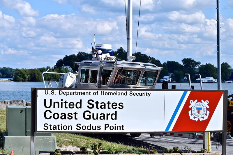 United States Coast Guard at Sodus Point Marina. United States Coast Guard, Homeland Security in the Marina Bay at Sodus Point stock images