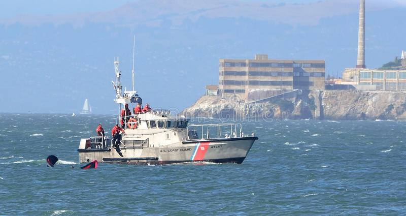 United States Coast Guard To The Rescue. United States Coast Guard rescuing kite surfer in the San Francisco Bay royalty free stock images