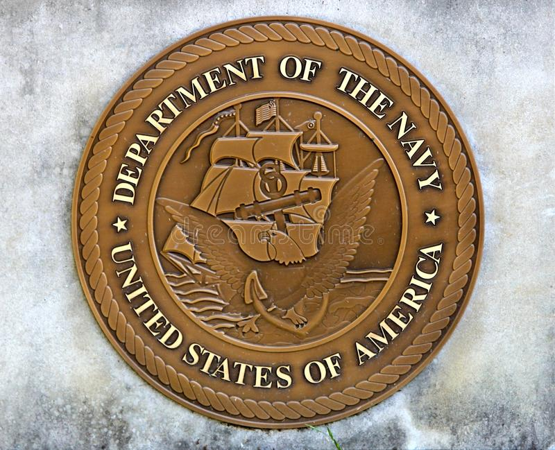 Navy of the United States Challenge Coin. United States of America Department of the Navy Challenge Coin Embedded in a concrete slab royalty free stock photos