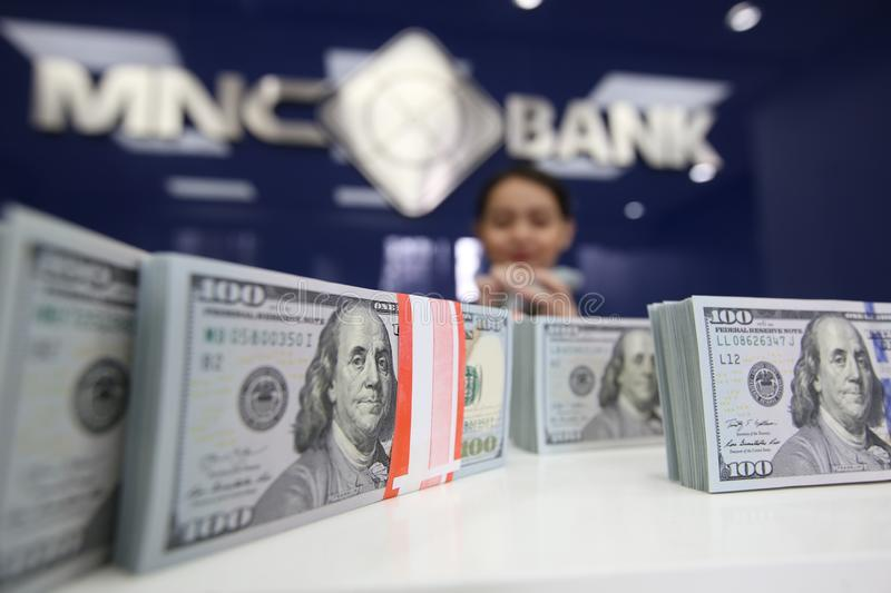 United States dollar. The employee shows the United States dollar at MNC Bank, Jakarta, Indonesia royalty free stock photo