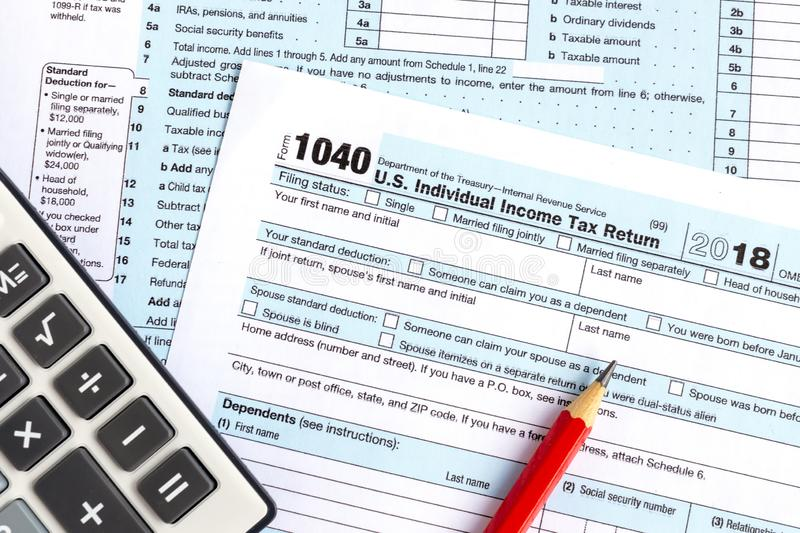 Income tax return IRS 1040. United States federal income tax return IRS 1040 documents and calculator royalty free stock photo