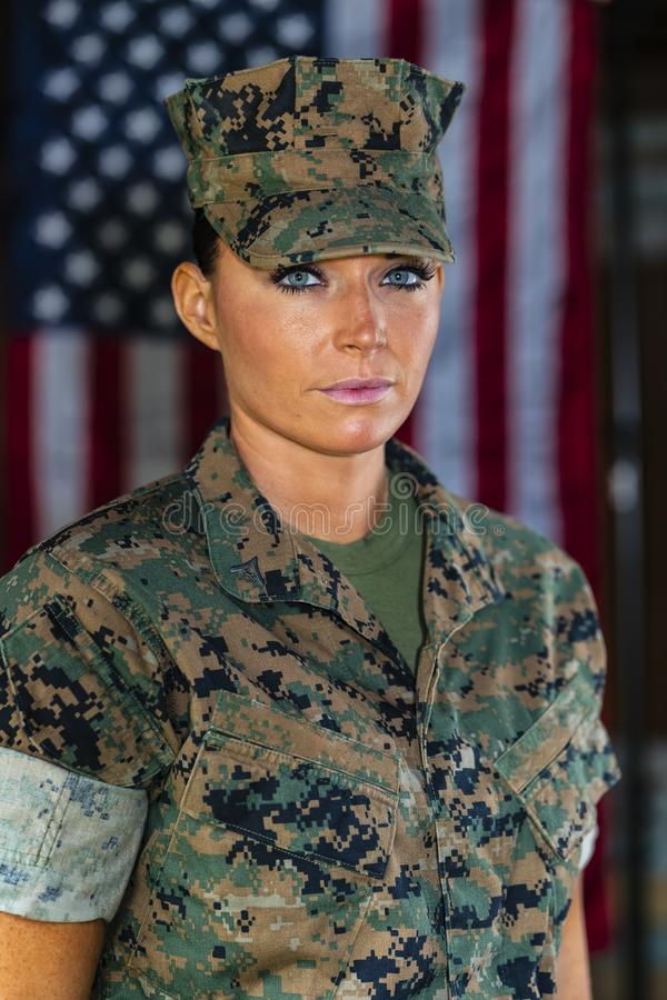 A United States Female Marine Posing In A Military Uniform. A female military Marine posing in a military uniform stock photography
