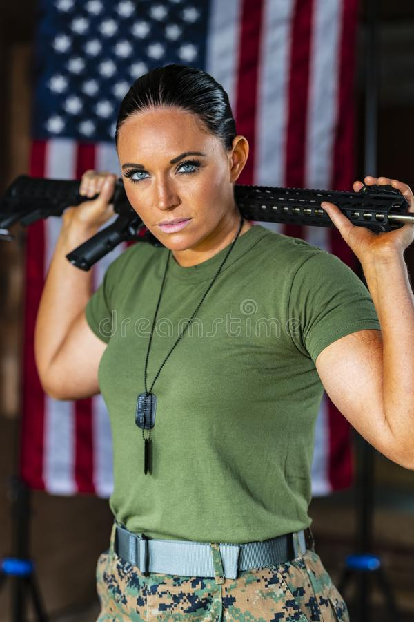 A United States Female Marine Posing In A Military Uniform. A female military Marine posing in a military uniform royalty free stock images