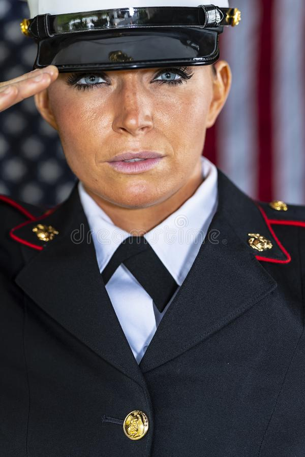 A United States Female Marine Posing In A Military Uniform. A female military Marine posing in a military uniform royalty free stock photo