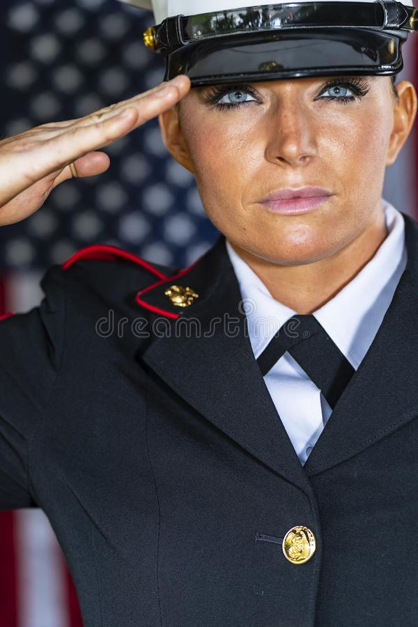 A United States Female Marine Posing In A Military Uniform. A female military Marine posing in a military uniform stock image
