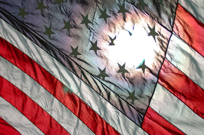 United states flag. USA flag diagonal with sun shining through the back stock photo