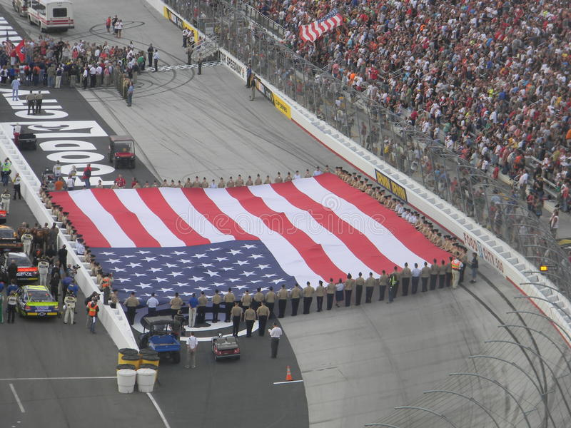 United States Flag at Bristol Motor Speedway. NASCAR races in Bristol Motor Speedway, Bristol TN, Flag military ceremony before the races royalty free stock photos