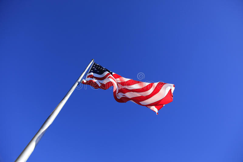 United States Flag at Chimney Rock. The United States Flag at Chimney Rock in Chimney Rock North Carolina stock image