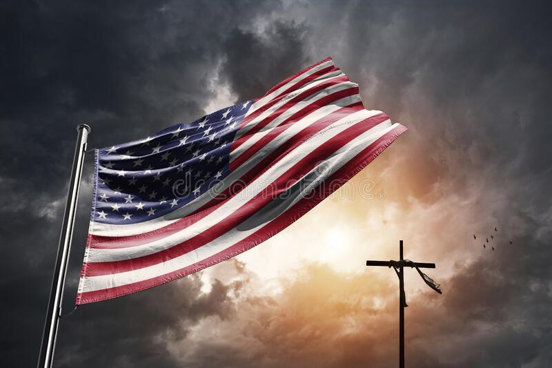 United States flag with christian cross. On a dramatic sunset royalty free stock image